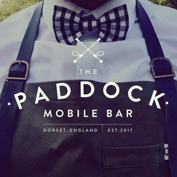 The Paddock mobile bar logo on uniform