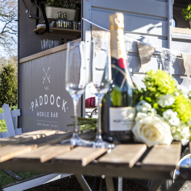 The paddock mobile bar with a bottle of champagne infornt